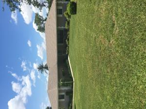 NO RESTRICTIONS - OVER 1/2 ACRE MANICURED PROPERTYThis Lovely, one-owner Florida Style home sits on over 1/2 acre of quiet park like setting property in a much sought after location. I-95, shopping, parks and beaches are located conveniently close by. Spacious 3/2 with 2 1/2 car garage, with an oversized driveway. Roof is5 years young, A/C was replaced in 2019, irrigation system on a well, county water, large OUTBUILDING. No HOA, no restrictions on this beautifully manicured property and well maintained home. This one will go FAST!