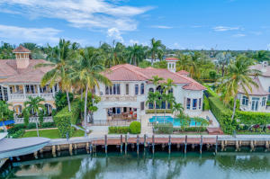 Luxury Custom Waterfront Estate in gated community of Harbour Isles. Expansive canal views, 87 ft of water frontage, private dock and 12,000LB High Tide lift. 30KW Generac Generator. Home is located next to a nature preserve. 4 bedroom, 5 full bath, 2 half baths, 4 car garage, pool and spa, boasting a total of 8,183 sq ft. and 6,125 sq ft of living space. Features include all impact windows, (4) 2018 A/C units. Grand marble foyer leads into the living room with coffered hand painted ceilings. Arched entries into rooms, custom crown molding, custom chandeliers, custom wall accents and plantation shutters throughout. 24 x 24 marble floors throughout 1st floor.