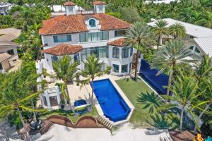 This magnificent estate was designed and built by the professional golfer Jesper Parnevik and his wife Mia. In 2002 they were ahead of their time in understanding what buyers would want in 2020. This home is crisp and clean,  white and airy, architecturally stunning with a Scandinavian flare and sits directly on the pristine intracoastal waters of Jupiter, Florida. Five bedrooms in the main house, 4 in the guest house make up for over 13,000 sf. overlooking your own private beach and 120 ft dock. An entertainment room, media room, 1000 bottle wine room, gym, spa, and putting green are some of the spectacular features of this masterpiece. Dont wait to start to live the Florida lifestyle. Life is too short.