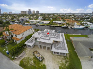 Great Opportunity to own a brand new Singer Island waterfront pool home with room for an 80 foot yacht. Expected completion November 2020. 4 bedrooms plus den/office.  5.5 bathrooms. Home has a light and bright Southern exposure with a short walk to Singer Islands beautiful beaches. Located on one of the best canals on Singer Island and less than 10 minutes to the inlet by boat. Call for more details.