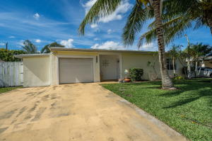 This Beautiful 3 bedroom, 2 bathroom home with an expansive pool, has a fully enclosed private fence and a pergola that is perfect for outdoor dining and entertaining. The upgraded kitchen features stainless steel appliances, with a gas stove and both bathrooms have been remodeled. Located close to shopping, dining, airport and beaches, this home offers complete convenience without any HOA!!