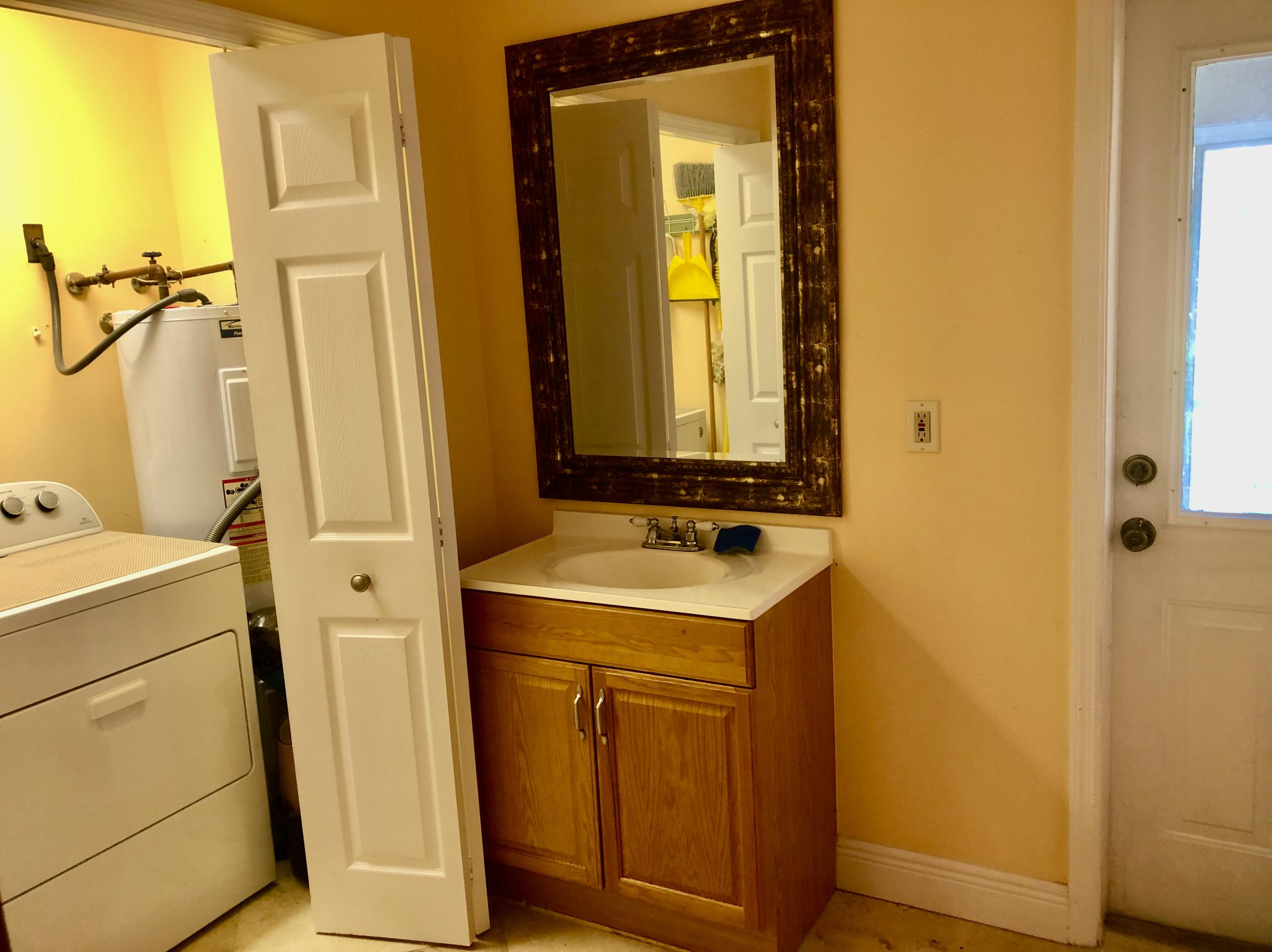 Utility room with door to outside