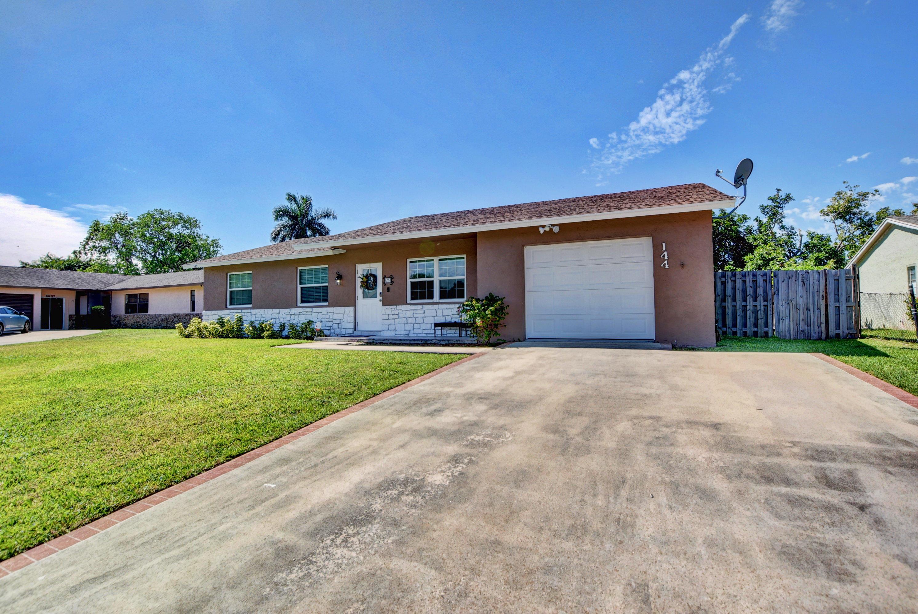 144 Martin Circle Royal Palm Beach, FL 33411