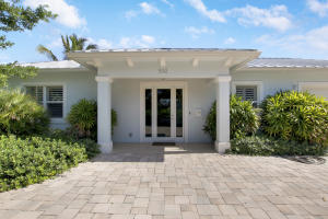 Custom Waterfront Estate built in 2018, situated on an over sized 26,000+Sqft Highly Elevated Lot. Located within walking/paddle boarding distance to Frigates, both Anchorage and Lakeside Park. This coastal inspired Key West custom build was well thought out featuring a gorgeous seamless Metal Roof and all Impact windows! Outside is surrounded with tropical landscaping and wonderful outdoor living. Inside you will not be disappointed as you are greeted with Volume 10ft+ ceilings covered in crown molding, new designer wood look tile, and tons of natural light as your eye catches a glimpse of the pool and backyard oasis.  As expected the master is oriented off the pool, and the split bedroom floor plan puts the guest