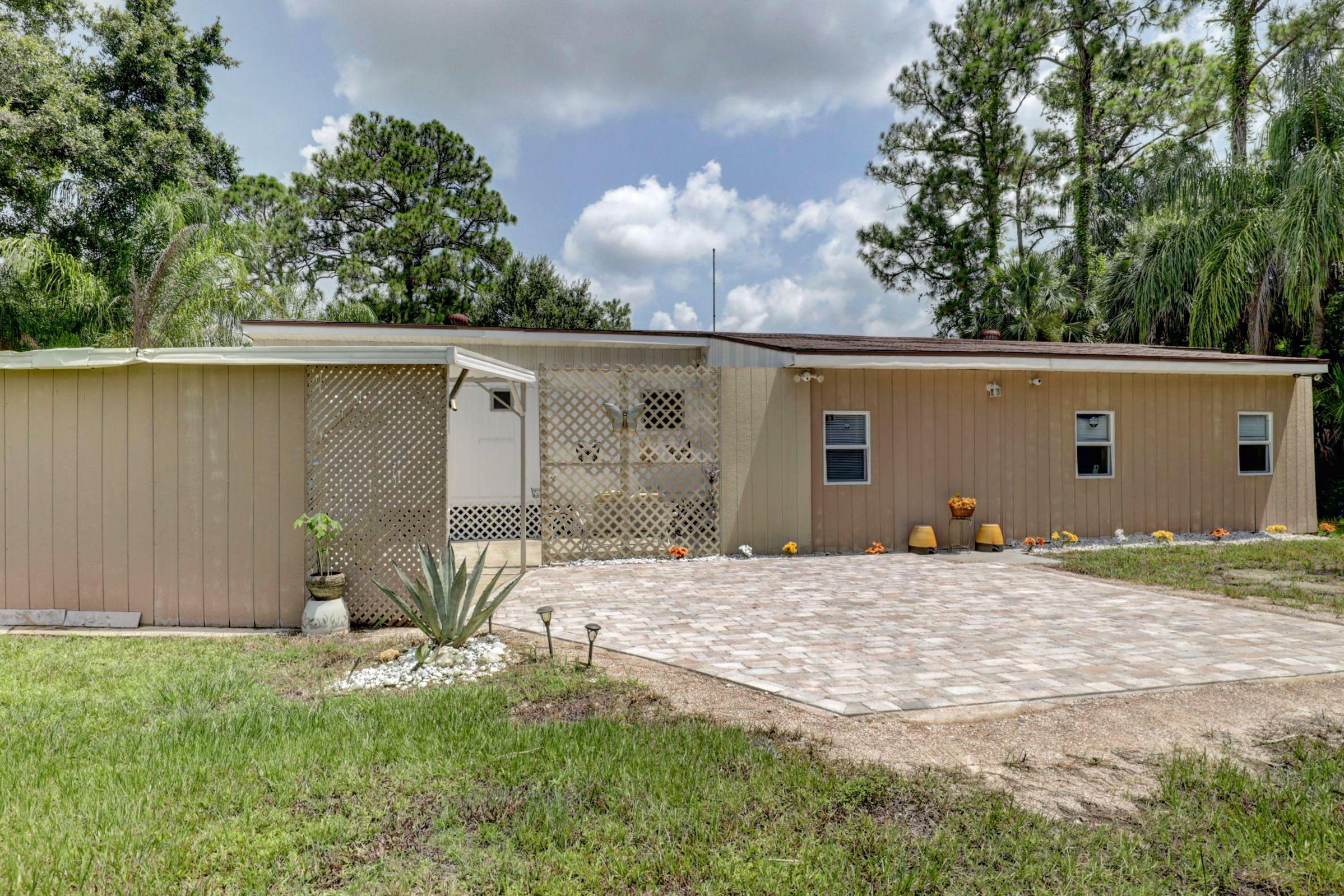 Home for sale in CAROLINA TRAILER HOMESITES Palm City Florida