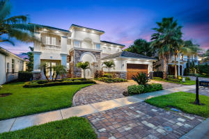 Beautiful sanctuary tucked in alongside the nearly 600 acre Juno Beach Natural Preserve.  The lush backyard oasis is complete with a resort style heated pool and spa, large patio deck and an upgraded summer kitchen making this a great home for entertaining or simply enjoying paradise in private.  Take in the grandeur of the two story front entry and living area; this home features 5 bedrooms/ 5 bathrooms, 2 additional rooms that can be utilized as a den/office, 2 master suites, with one located on the main level, and a spacious family room and dining room adjacent to the ultimate chefs kitchen.  Located on a secluded cul-de-sac, minutes to the beach, great restaurants and shopping - this lovely home has it all.