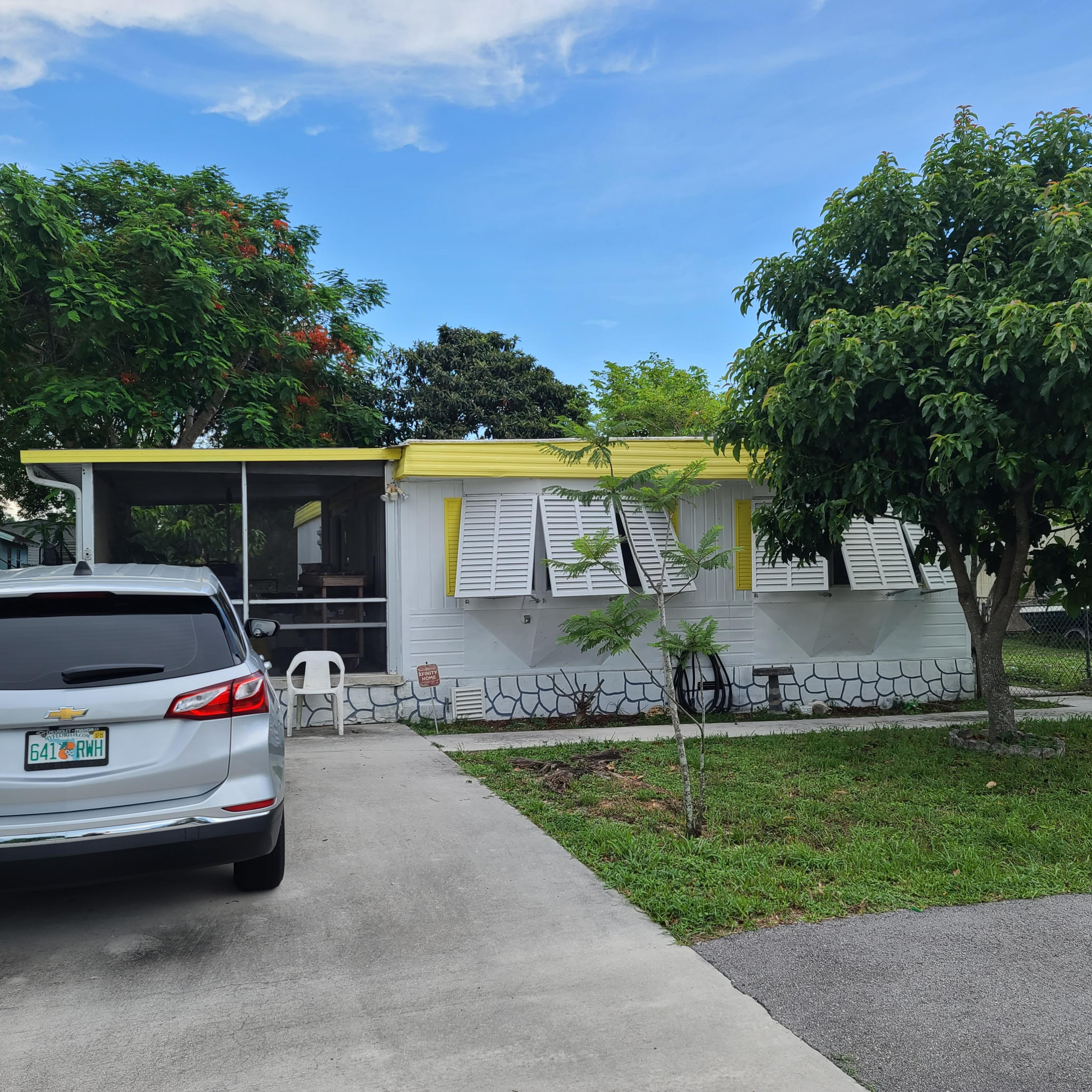 11869 SW Sandalfoot Blvd Boulevard  Boca Raton FL 33428