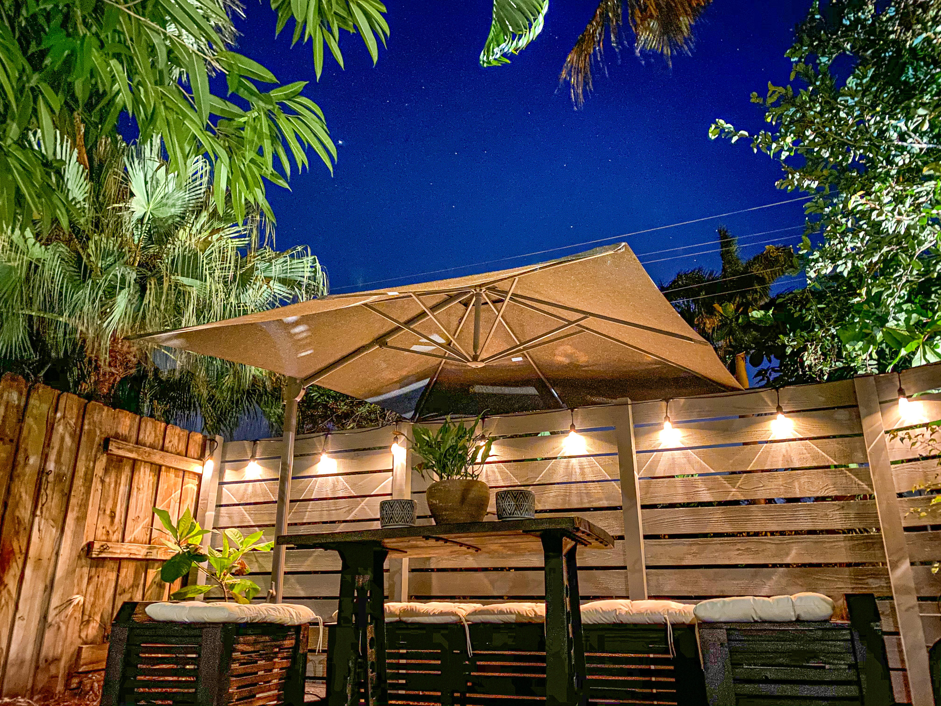 Backyard seating area with lights