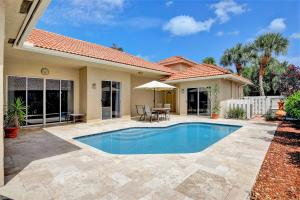 This is a rarely available and sought after courtyard POOL home, with a fabulous  lake and golf course view within the desirable community of Winston Trails. Once you walk through the double doors there is a guest house to the left which is great for a nanny, an in-law, a home office or even a teenager who wants their own space & a sumptuous pool which is surrounded by a Travertine patio.  The main home is surrounded by windows galore and is spacious and is great for entertaining. This floor plan is an open two-way split with the master and the 2nd bedroom on opposite sides of the home. Also, there is an oversized master suite with a fabulous view of the lake & golf course and a brand new stunning master bath done in marble, with dual sinks, a separate step down shower with river rock