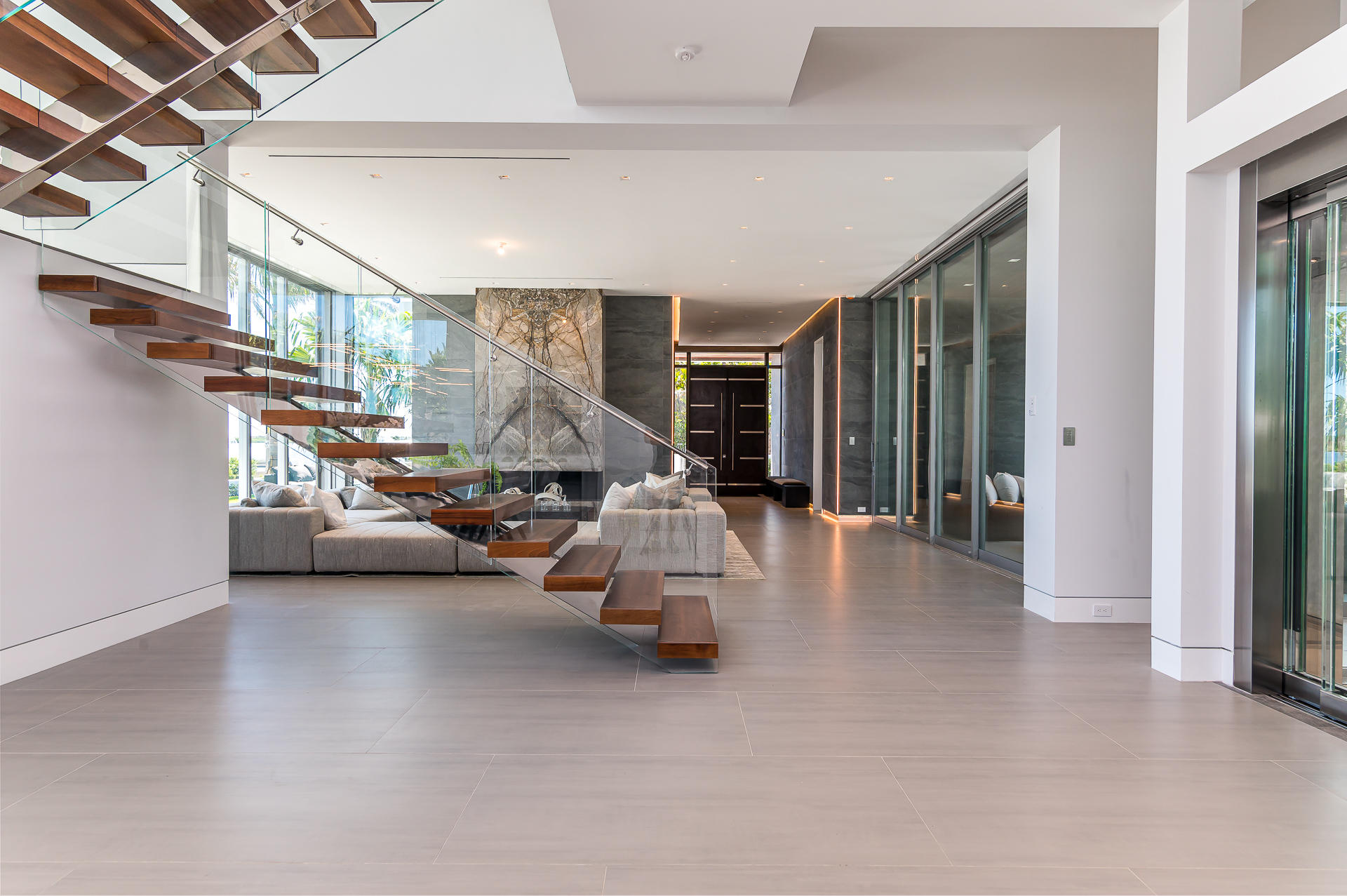Living Room with Glass Staircase