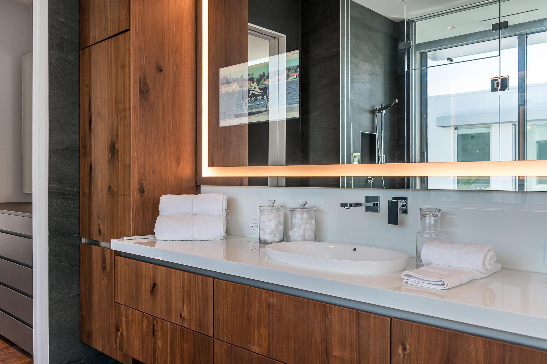 Television in master bathroom mirror