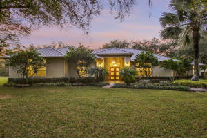 This immaculate custom-built CBS home in Jupiter Farms features 5 bedrooms plus office, 4 full baths, and over 4,884 sq ft (living) and is a MUST SEE! And with nearly 5 fenced acres, this property truly has BOTH the privacy and room you have been looking for. Custom built in 2006, this home has complete impact glass windows, metal roof, beautiful mahogany wood doors imported from Portugal, stone wood-burning fireplace, and amazing Chefs kitchen. This is THE KITCHEN youve been waiting for! With a cook island, 42 wood cabinetry, steel hood w/ exhaust, double wall oven, high-end stainless appliances, and large walk-in pantry, Gordon Ramsey wouldnt be disappointed. All bedrooms are spacious with 10 ceilings and have shelved walk-in closets. This home is pool ready with a cabana bathroom