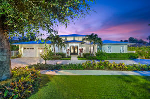 A rare find. Located in coveted Hidden Key this 2015 Bermuda style home has over 100 of water frontage + an 80 dock. Offering the finest in modern Florida living, this home boasts over 4,300 SF on one level.  Custom double doors and a two story foyer lead to  grand living room w/ coffered ceiling, wine bar + gas fireplace. Design elements include tile or wood flooring in every room, high ceilings, custom built ins, coastal/neutral hues + transom windows.  Open kitchen is a Chefs dream w/ Thermador + Miele appliances, Huge fridge, pantry + Carrera marble island. Spacious Master BR suite is private + serene.  Additional rooms include 4 BRs + Office. Home design blends indoor + outdoor living beautifully, w/ large covered lanai off family room leading to Pool + picturesque seating area.