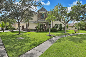 Spacious 5BR/4BA two story home in the family-friendly community of Osprey in Country Cove Estates, Lake Worth. Enter through decorative, leaded-glass front doors into large foyer.  Wood-burning fireplace sets the tone.  Formal dining room, kitchen with elegant medium wood cabinets, granite counters and  new refrigerator.  On the 2nd-floor,  find master suites - one complete with sitting area - along with an additional 2 bedrooms and 1 bathroom, and generous landing.  Covered/open outdoor patio with gorgeous lake view, built in bbq and plenty of grassy  area, round out this fantastic  home. A-rated schools and ready for your  family today!