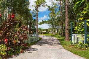 An incredible rare gem with almost 11 contiguous acres in one of Palm Beach Countys most desirable equestrian communities.   Beautiful Fox Trail features miles and miles of luxurious bridle paths.  Only minutes to all of Wellingtons equestrian venues, yet without paying Wellington prices.  This incredible property features an exquisitely remodeled 4 bedroom, 3.5 bath home with den, brand new aluminum roof with a LIFETIME warranty, barn, gorgeous upgraded guesthouse which is even equipped with a steam sauna!  Full-house reverse osmosis, air conditioned feed/tack room, heated saltwater pool, brand new screen enclosure with summer kitchen, 12 zone irrigation, outdoor wood burning fireplace, plantation shutters throughout, Brazilian teak floors, wet bar, central vacuum, new ACs, solid wood