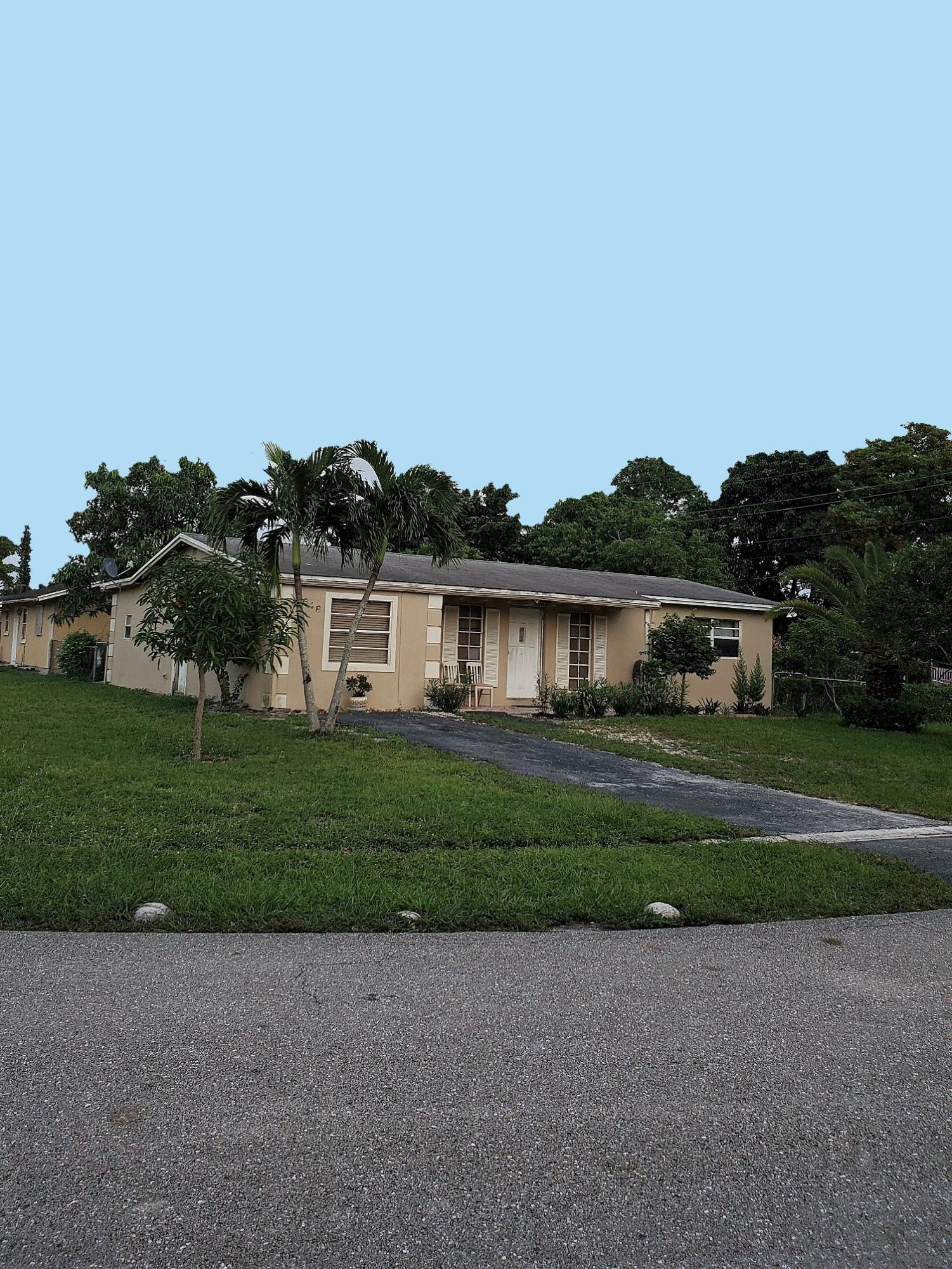 Home for sale in LAKE WORTH HILLS 3RD ADD IN Greenacres Florida