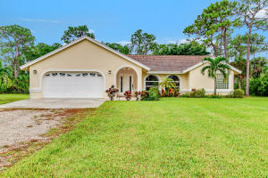 Adorable Loxahatchee home on over an acre, renvoated completely within the last two years, plumbing, floors, bathrooms, kitchen, appliances, water system, AC, hot water heater.  This home is move in ready.  Close to shopping and restaurants.