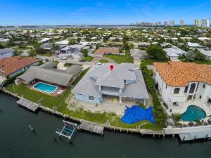 Great Opportunity to own a brand new Singer Island waterfront pool home with room for an 80 foot yacht! Expected completion February 2021. 4 bedrooms plus den/office.  5.5 bathrooms. Master bedroom on first floor. Home has a light and bright Southern exposure with a short walk to Singer Islands beautiful beaches. Located on one of the best canals on Singer Island and less than 10 minutes to the inlet by boat. Call for more details!
