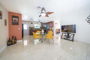 Large Single family Home on the Residential area near historic district, close to City Place and Howard Park. 5 minutes from Kravis Center and PBC Convention Center. Close to all DOWNTOWN and 8 minutes to the Beach.9 minutes from the WPB Airport.Up dated bathrooms and kitchen. AC 4 years with guaranty for 10 years. Price to sell. Ceramic floor in most of the house.