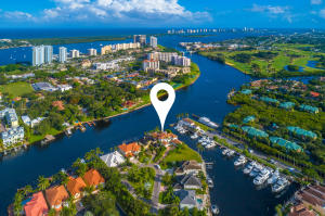 Reduced $250K, Now $3,700,000.Boaters Paradise! 240 feet of Deep Waterfront on a Point Lot, in a No wake zone, expansive wide view to the north and south on the intracoastal, NO fixed bridges to Ocean. 2 boat lifts, 30k lb and 14k lb. 15 minutes to Peanut Island,Palm Beach Inlet  and Jupiter Inlet.SouthEast Exposure with beautiful breezes! 4 bedroom/5.1 bath, over 4900 sq ft, 3 car garage, open floor plan with high ceilings, pool, spa and summer kitchen with new appliances. PRICED to Sell at $3,700,000.00 Dont miss the opportunity to own this GEM in Beautiful Palm Beaches!!