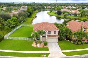 A rare find in this community! This home comes with an additional 3500 sq. ft of deeded yard, that is completely fenced in!! You can also enjoy the best lake view from your heated, salt water pool.  Plenty of closet space, an updated master bath and kitchen, hurricane accordion shutters, great room sizes, updated pool screen for safety & durability and the ability to enjoy the town fireworks, on the 4th of July, right from your backyard!!This great family neighborhood is in walking distance to both the Elementary and Middle School & includes a ton of community amenities!