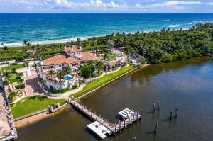 A Palatial Waterfront Estate on over 4.1 Acres Delivers Every Amenity You Could Want! This one of a kind estate is located in the heart of Palm Beach County with high security and a tunnel built underneath the home directly to your private beach and your own cabana.  With more than 12,000 SF under air, this 3 story 9 bedroom, 9 full bath and 2 half baths is one of the most exquisite estates among those of the neighboring rich and famous, who like you, appreciate the incredible views while enjoying a lifestyle of privacy. The mansions features are too many to mention, but foremost among them are the massive room sizes, cathedral and vaulted ceilings, and the perfect use of marble, tile, wood and carpet flooring throughout the home.