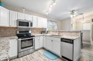 Excellent value and location in this recently updated home. New white kitchen with granite countertops, subway tile backsplash and stainless steel appliances. Wood look tile floors throughout. New baths. Impact glass, NO popcorn ceilings! A/C and water heater replaced in 2018. Large private backyard for entertaining with salt water pool and Aquacal pool heater. Beautifully landscaped. Circular driveway. Excellent West Boca Schools.