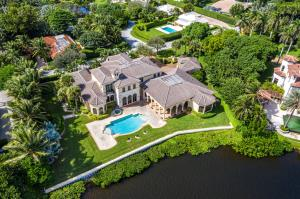 Enjoy Privacy & Upscale Waterfront Living on Beautiful Point Manalapan!This gorgeous Mediterranean-style home, built by renowned Wadsworth Builders, offers over 8,100 SF of living space with 5 bedrooms and 5.5 bath located on .74 acres of waterfront property on Point Manalapan, a beautiful, secure south Florida island community. Enter the Chicago Brick circular drive and walk through the columned and arched entryway through the custom, solid wood arched front door and into the gorgeous marble floored foyer that leads to the homes open floor plan.