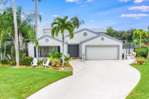 Oversized 5 bedroom single family home WITH pool in desirable Elysium at Arbors community in Royal Palm Beach!  Open concept living/dining with tile flooring throughout. Crown molding. Cathedral ceilings with sky lights. Updated galley kitchen with granite counter-tops, SS appliances and tile backsplash. Gorgeous master bathroom has been completely remodeled and features oversized walk-in shower. Fenced in pool area w/new diamond Brite. Roof 2018.  Real working fireplace.