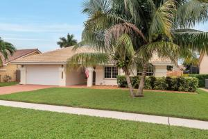 Located in the heart of Boynton Beach, close to I95 & Turnpike sits your new home! Completely updated, this home is ready for the most discerning buyer. You are greeted with lush tropical landscaping, and as you step inside the vaulted ceilings, natural light, and open concept floor plan are sure to leave you speechless. The recently updated kitchen features shaker style cabinets, granite countertops, stainless steel appliances & looks out over the dining room and onto the pool. The fully fenced back yard is an oasis with an oversized pool and is perfect for relaxing. The master suite also looks out to the pool, features vaulted ceilings, huge closets, and a beautiful ensuite bathroom. The split bedroom floor plan and 2 guest suites share a beautifully updated bath