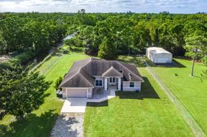 AMAZING! This 4 bed, 3 bath NO HOA split plan home has a MASSIVE lot just under 2 acres w/ DOUBLE ROAD ACCESS, complete chain-link fencing, power gait at front driveway & a 1,000 sq ft warehouse w/ electricity on a concrete slab- PERFECT FOR A BARN, mobile home or storing a boat, car or large equipment. The yard has plenty of room to build a pool &/or large area for entertaining family & friends or even a large guest house. The home features 2 huge living areas, large formal dining room & upgraded kitchen w/ newer stainless appliances & NEW washer. Each bedroom has plenty of closet space & share 2 full baths- one being a cabana bath that leads out back. The master suite is spacious w/ backyard access, 2 walk-ins & large en-suite bath w/ separate shower & spa-like tub. Other features
