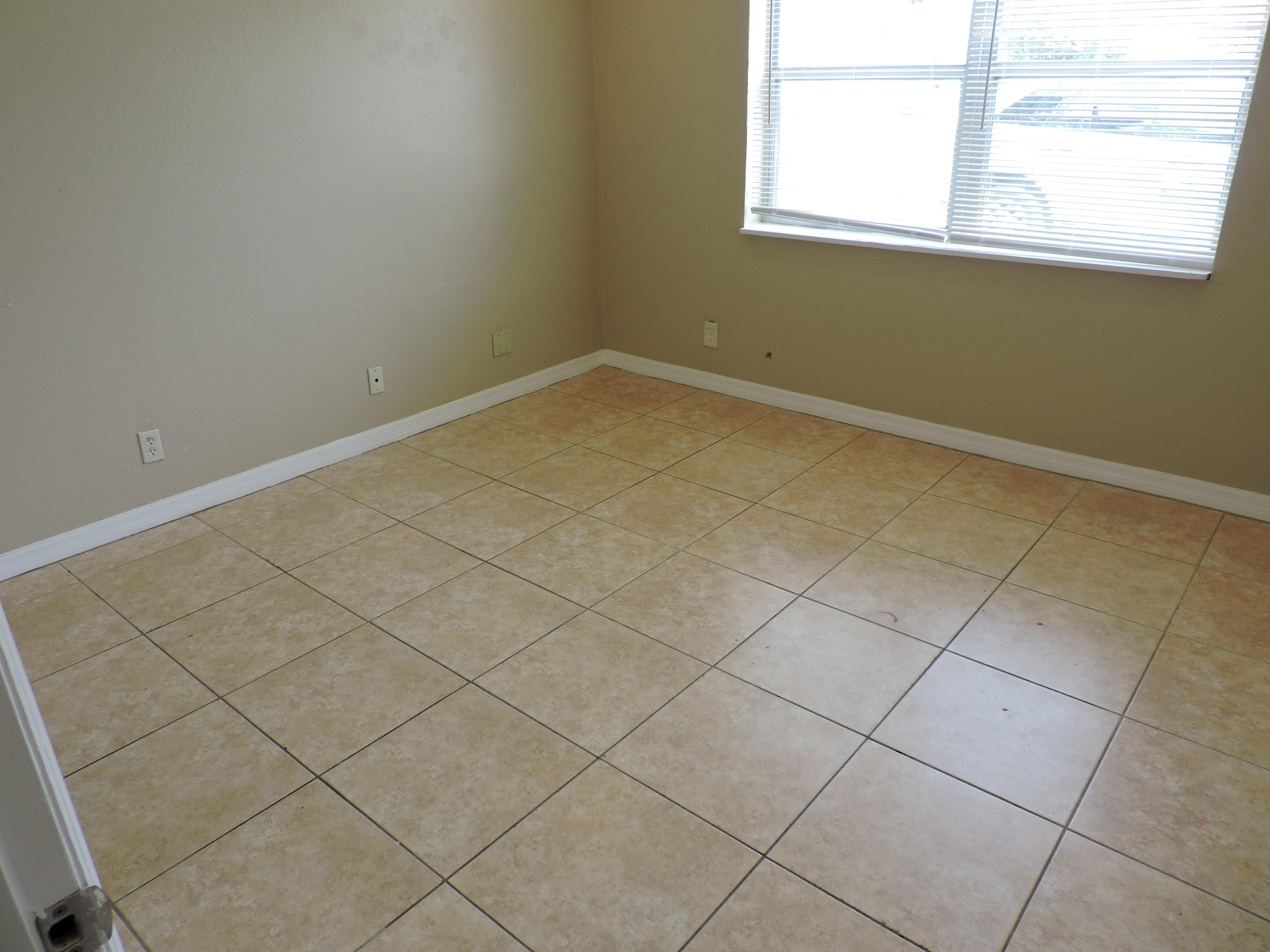 third bedroom with tile flooring