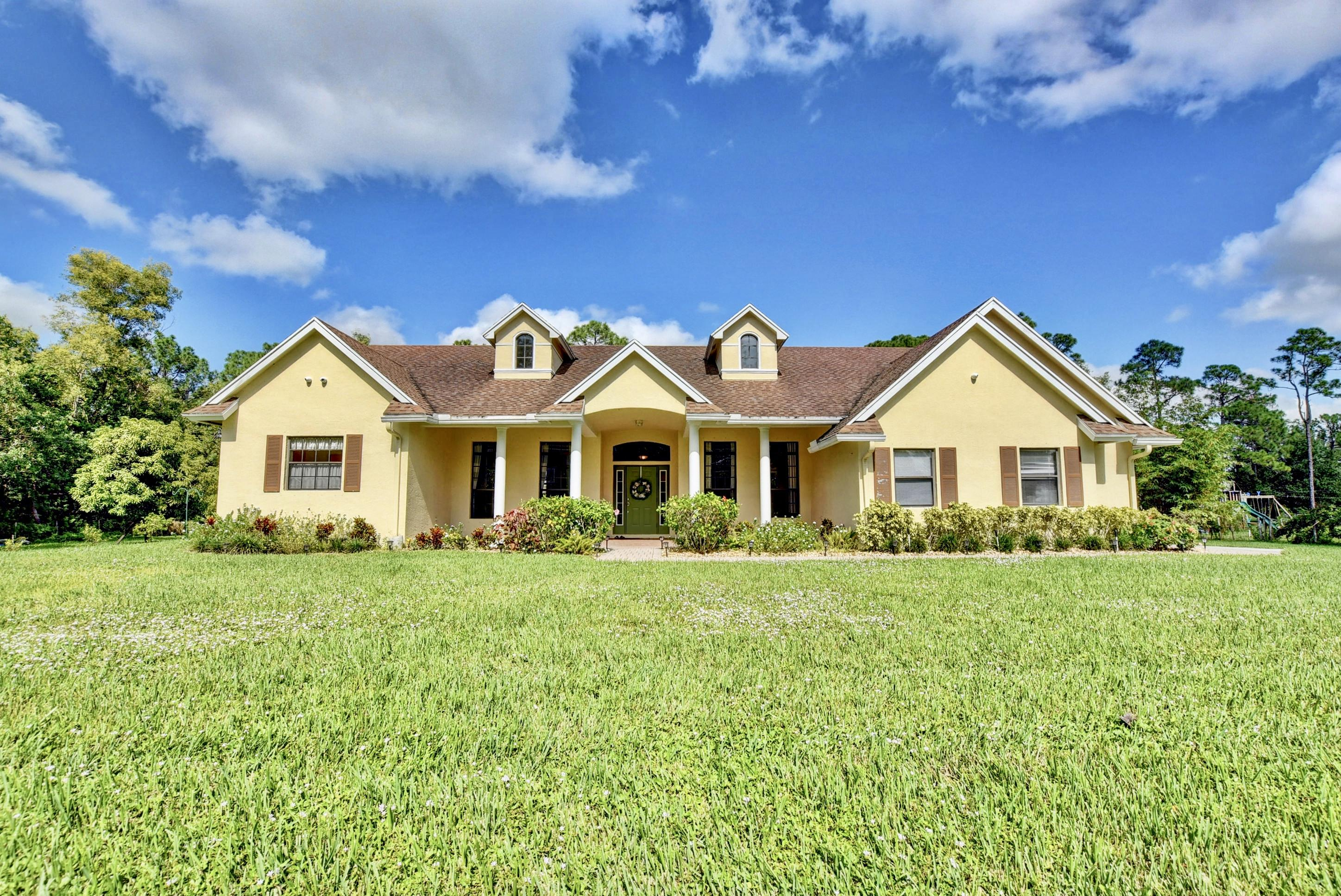 Home for sale in The Acreage/ Unincorporated Loxahatchee Florida