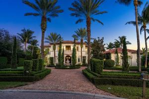 This Mediterranean inspired, intracoastal estate is situated on 0.74 acres on a secluded cul-de-sac located on prestigious Manalapan Point, one of Floridas finest and most exclusive island towns, located just south of renowned Palm Beach and north of trendy Delray Beach.  Custom designed and finished in 2005, this two-story residence features: 6 bedrooms (each w/ private terrace)/7 full and 2 half bathrooms, an oversized elevator, 150 of direct water frontage with dock and boat lift, and 11,535 sq. ft of luxurious living space (9,704 sq. ft. under air). The Master Suite features a panoramic water view from its covered lanai.  The outdoor living area includes a breathtaking infinity pool, hot tub and outdoor entertaining area.