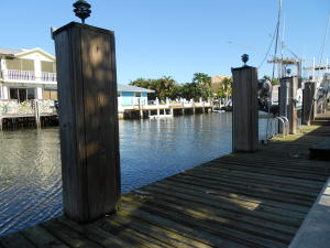 Fisherman and boaters paradise with 75 of direct waterfront and only 9 houses away from the intracoastal that leads to the inlet.  This solid home has so much to offer; boat dock, boat lift, salt water chlorinated pool system which has both heater and chiller, making the pool the perfect temperature year round.   The pool pump 1yr old. Pavered patio deck , retractable awning. Impact windows and doors were replaced in 04, roof 99 and a/c less than a year old.  The home is also wired for a generator.  Come and make this home your slice of paradise.