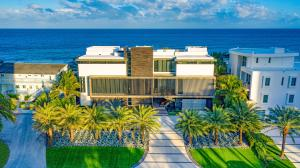 Monumental Modern Oceanfront Estate located on prized South Ocean Blvd on the Northern shores of Boca Raton in Highland Beach. A gated motor court ushers guests to this Tour de Force concrete and stone clad 4-level Oceanfront Estate sited on 120 +/- ft of beachfrontage with striking brise soleil architectural detailing. The main living level (2nd level) encompasses a living room, dining room, club room, theater/screening room, Designer floating kitchen and separate butlers/catering kitchen for entertaining. 3rd level Luxe master wing features a sitting room, Spa-like bath with atrium wellness oasis, Poliform boutique closet, exercise room and oceanfront office/study. Two guest bedrooms suites are also featured on this level.