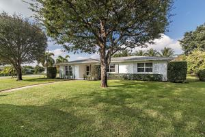 Located on a large 14,000+ square foot lot in the heart of Lake Clarke Shores, this wonderfully maintained home exudes South Florida lifestyle. Including 3 bedrooms and 2 bathrooms, this 3,361 total square footage home is ready for its new owners and some interior updating. The home has full hurricane impact windows, open floor plan kitchen, ample room for a swimming pool, huge backyard and is located near I-95, City Place and area beaches.
