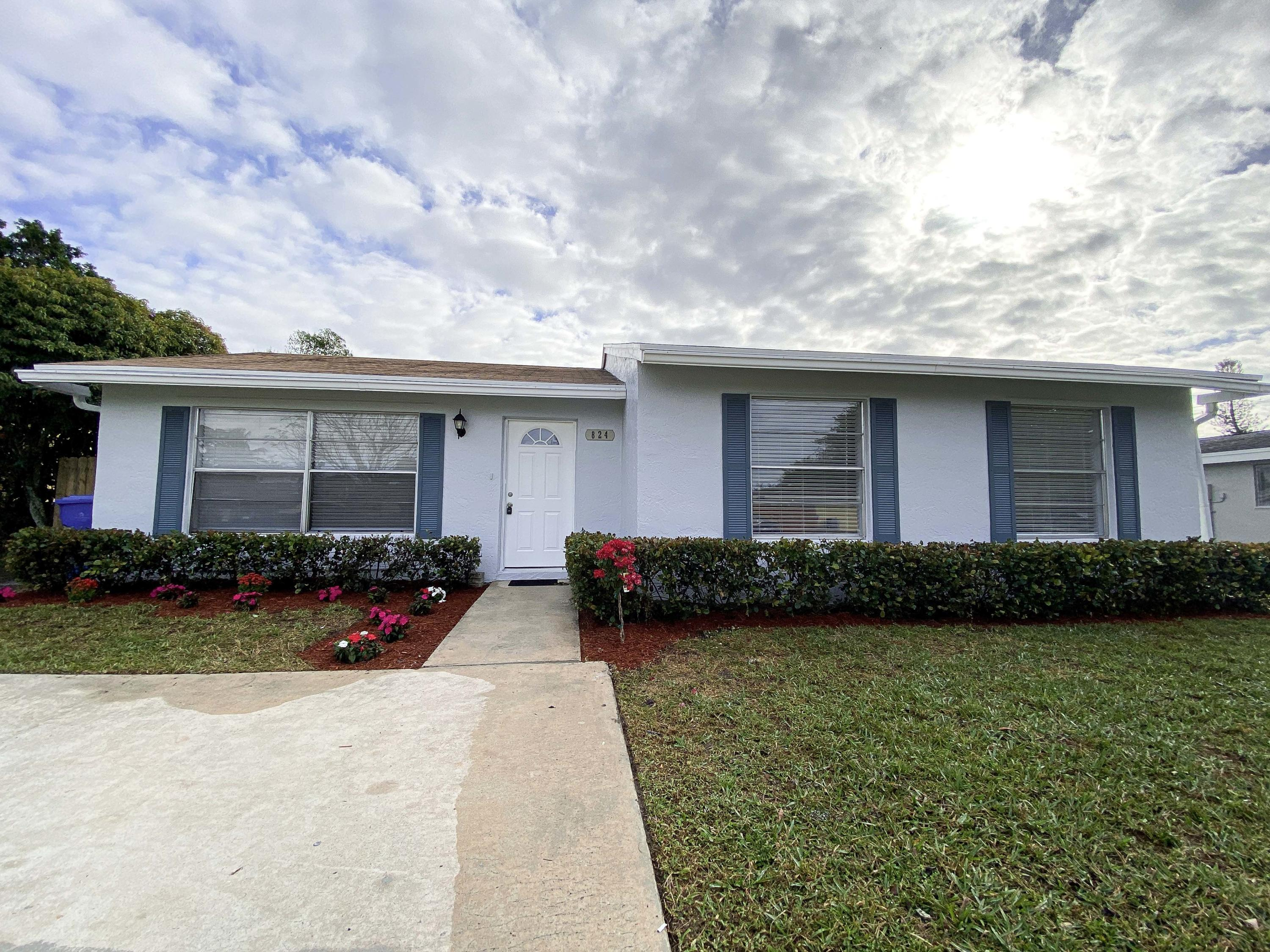 Home for sale in PALM BEACH COLONY SECS 1 & 2 IN PB 26 PGS 107 TO 110 INC Royal Palm Beach Florida