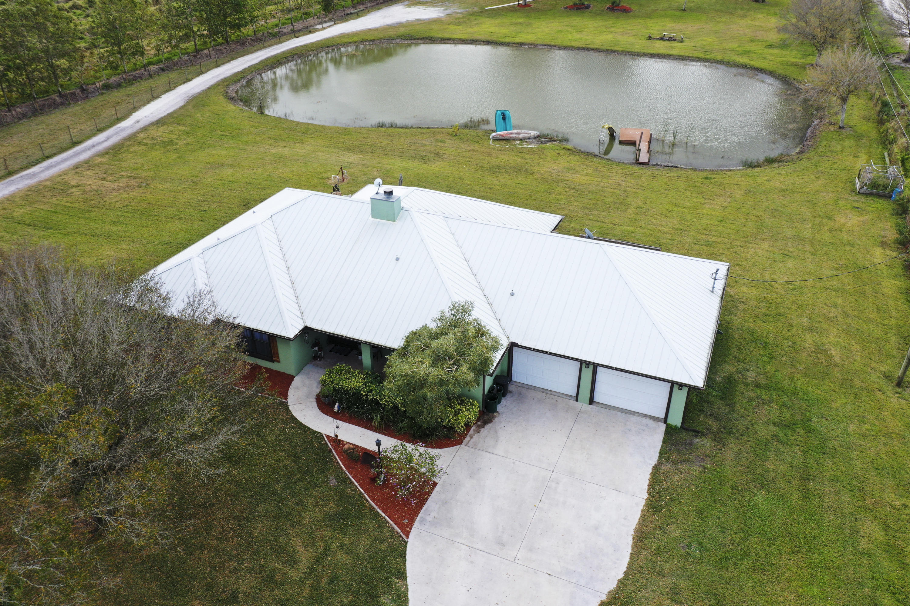 aerial house A with pond