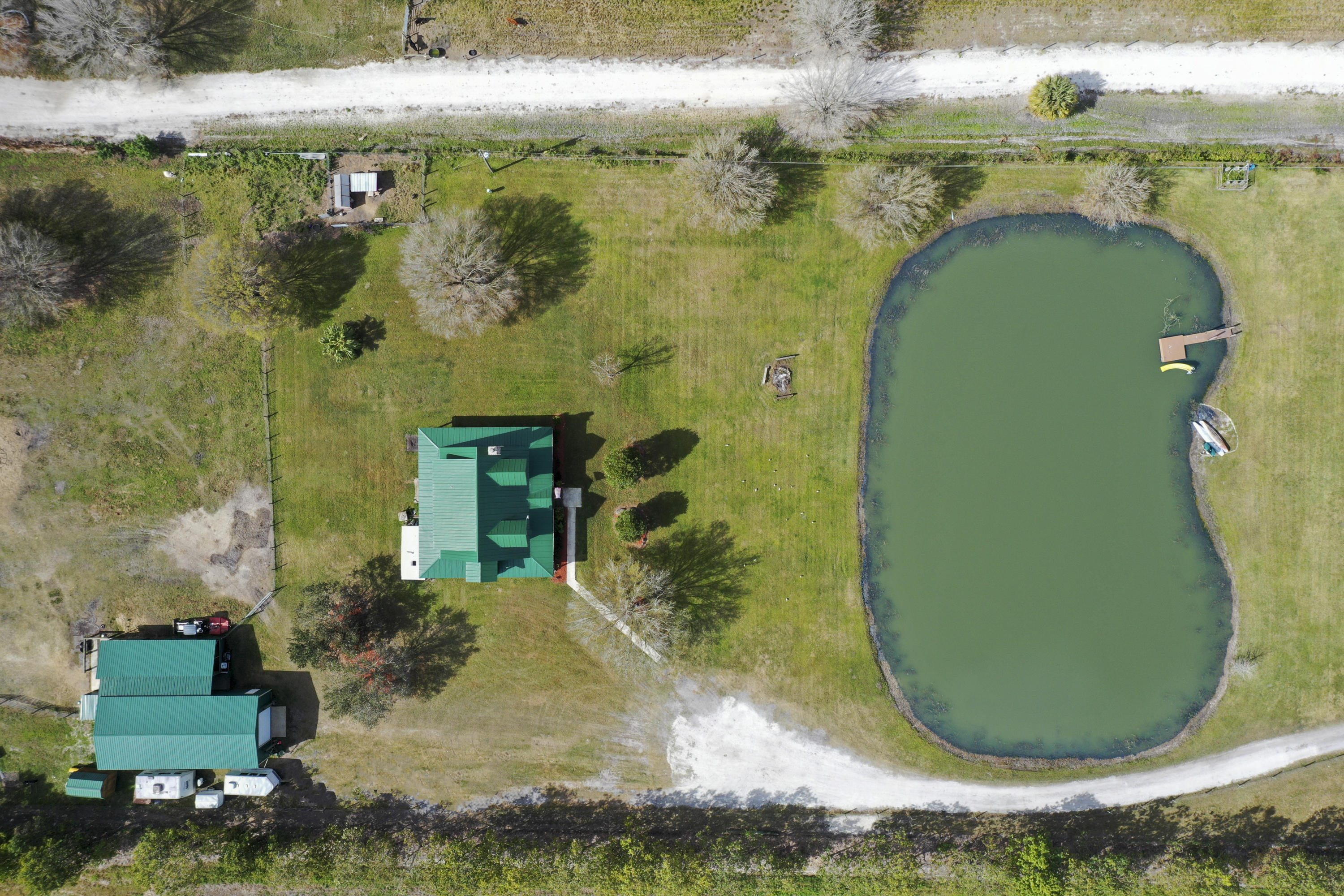 aerial of cabin, barn and pond