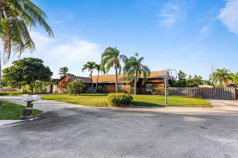 Home for sale in HYPOLUXO VILLAGE 1 Lake Worth Florida