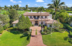 Enjoy spectacular golf course and sparkling water views from this custom, two-story, Mizner inspired, home overlooking the 13th fairway at Lost Tree Club.  Move in ready, this gracious home with generously proportioned rooms and great flow for effortless entertaining, features a stunning living room with cast stone fireplace, a handsome chestnut paneled study, and a lovely master suite on the ground level.  The second floor offers two private wings with dedicated staircases, each with two bedrooms and ensuite baths, ideal for family and friends.