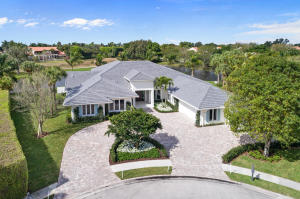 Elevated to the highest level of luxury and comfort, this unique property sits on a 3/4 acre lot and spans 290 of direct water frontage in the heart of Palm Beach Polo. Completely redesigned with the highest quality finishes throughout, this single-story residence features 5 bedrooms, 6 baths, office and state-of-the-art kitchen with Thermador appliances. Floor to ceiling windows and doors in all living areas lend to the airy aesthetic of the space, providing sweeping vistas of the Dunes Preserve and beyond. The oversized outdoor living area with retractable screens is superb for entertaining and provides a serene setting to enjoy the incredible Florida sunsets. Expanded circular motor court offers easy access to all garages and provides additional guest parking. Must see!