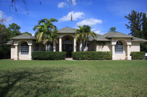 Beautiful 4/3/2 home in the country yet close to schools and shopping.  Tile and wood floors, large bedrooms plus a private office. Whole house RO system.  Newer AC systems.  Large screened patio, in-ground pool.  Well landscaped and irrigated yard.  Extra parking including 50amp RV parking.