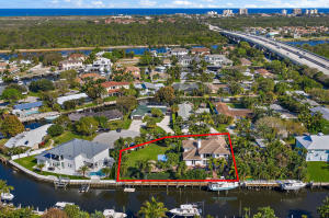 Beautiful waterfront home on a double lot with 145 of waterfrontage on .36 acres with no fixed bridge. There are endless opportunities with this double lot. The home was renovated between 2017 and 2018 with beautiful wood floors throughout, WOLF appliance, impact windows/ doors throughout, electric shades, plantation shutters, whole house generator, summer kitchen saltwater pool/spa, 3-HVACs, mosquito misters, 12,000 lb boat lift and smart home technology. Conveniently located 1.2 miles to the beach, minutes to shopping, restaurants, Palm Beach Internaitonal Airport and so much more.