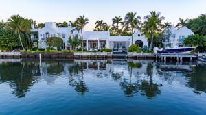 Direct intracoastal located close to Town & the beach. Incredibly conceived Bermudian gem, Tarpon Cove, affording an incredibly rare level of detail/authenticity. Perfectly poised & south facing w/232 of intracoastal frontage-great for boaters & water toys. To the north, the home overlooks rolling golf course greens. Winner of the Palm Beach Preservation Foundations 2017 Schuler Award for outstanding new architecture, as well as an AIA award for excellence in design & execution. Enchantingly designed this property includes: 6 BRs, 7+ full BAs, gym, 5 car garage, heated & salt treated pool, full house generator, smart home technology, water purification system, dock, boat lift, & magically appointed gardens. Tarpon Cove is a private paradise for the ultimate tropical retreat