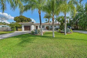 This pleasant single family home is on 1/4 of an acre and prime location to Intracoastal, nearby parks, the beach and a public boat ramp only 1/2 mile away.  The home has 3 bedrooms, 2 baths and 1 car garage.  Complete with a newer kitchen and porcelain tile floors throughout.  The oversized backyard has a large open patio with trellis and plenty of room for a pool, boat parking, house addition, etc.   Lots of potential to increase property value!  Roof 2001, AC approx 5 years old, washer dryer in garage.