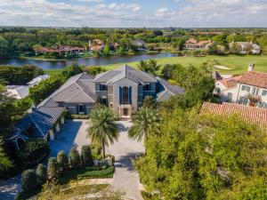 This property is extremely private on the cul-de-sac at the end of Hurlingham Drive! Featuring 5 bedrooms and 5.2 baths, it is absolutely stunning with volume ceilings and beautiful marble floors throughout. No expense has been spared on this gem! Renovation was done in 2019 - adding a relaxing salt water pool with spa and covered summer kitchen, gas fireplace and electric roll down screens. There is also a gorgeous wine cooler in the downstairs sitting area that can be viewed as you walk down the hall towards the office and master bedroom.  The upstairs features three guest bedrooms each with full bathrooms!  All three bedrooms also have a relaxing terrace to enjoy views of the golf course! Roof was also replaced in 2019. Dont let this exquisite property pass you by!!