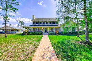 SOUTHERN CHARMER!!  Lovely Deer Run Horse Farm with true Southern flavor! Two story Colonial styled POOL home with 4/2.5/2 cg.  TWO SEPARATE barns, one with Grooms quarters.  11 STALLS, (barn1 has 6 stalls barn 2 has 5 stalls)  14 PADDOCKS!! You have 2 RUN IN STALLS in addition to the barns...so 13 STALLS IN ALL!  Barns have Hardy Board siding, METAL ROOFS, & AUTOMATIC WATERERS and are INSULATED!!  Barn 2 has 4 of its stalls with RUN IN PADDOCKS. Both barns have LIFE PROOF BARN PLANK FLOORING in apartment & tack rooms/office. OVERSIZED REGULATION DRESSAGE ARENA ((laser leveled) has GGT footing as does the training pen.  Lovely SPECTATOR VIEWING STAND next to Arena.  Irrigation System w/ heavy pump.Home has gleaming real wood floors, 1 New AC and ductwork(2020), New well pump 2020