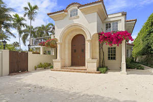Fantastic In-Town location on the ocean block of Clarke Avenue. Formal entry leads into oversized living room and dining room with fireplace. 7 BR/6.1 BA plus library, eat-in kitchen, elevator, family room, and 2 car garage. Beautiful backyard with loggia, fountain and pool. Enormous in town lot with over 18,700 sf per CRS system.